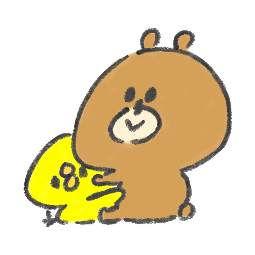 熊と抱き合っているひよこ