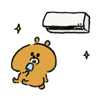エアコンの効いた部屋でアイスを食べて涼む熊