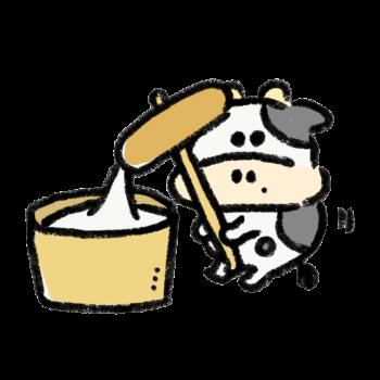 餅つきをする牛