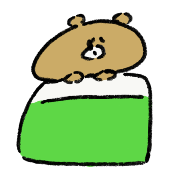 おふとんで眠る熊