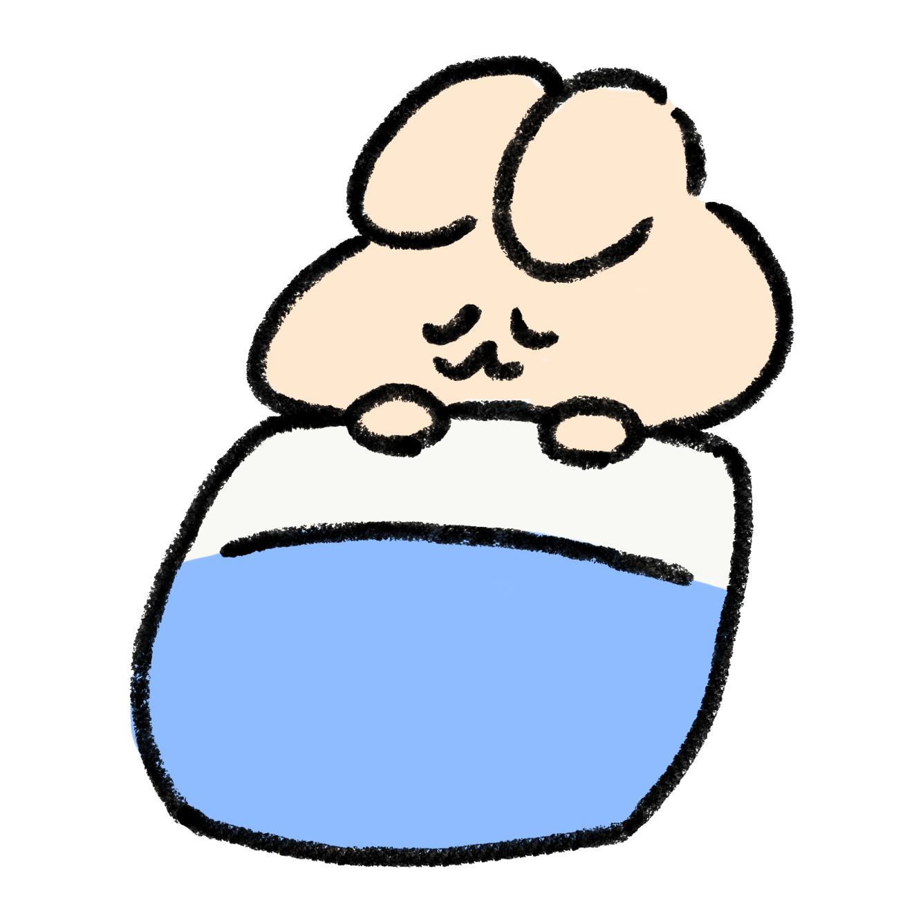 おふとんで眠るうさぎ
